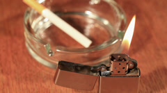 ZIPPO and ashtray with a cigarette - stock footage