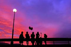 people shadow with sunset sky - stock photo