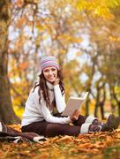 Young pretty woman on the autumn leaf Stock Photos