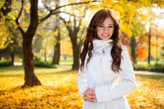 Stock Photo of beautiful girl in the autumn fall