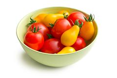 various tomatoes in bowl - stock photo