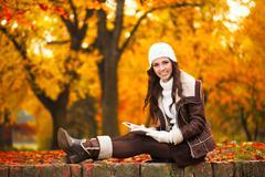 education in autumn park - stock photo