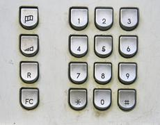 Telephone keyboard in public phone Stock Photos