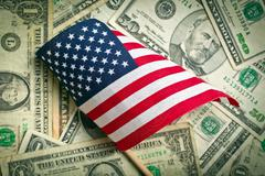 american flag with us dollars - stock photo
