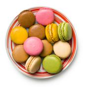 colorful macaroons on plate - stock photo