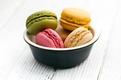 Colorful macaroons in bowl Stock Photos