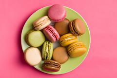 Colorful macaroons on plate Stock Photos