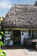 Entrance of a restaurant, The Blue Door Restaurant, Adare, County Limerick, - stock photo