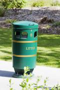 Garbage bin in a park, Adare, County Limerick, Republic of Ireland - stock photo