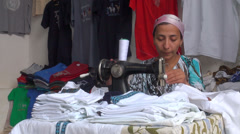 Lady sewing clothes with old machine, tourism, Uzbekistan Stock Footage