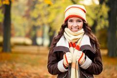 Girl feeling cold in autumn park Stock Photos