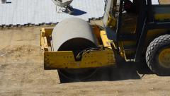 Roller compactor at road construction site Stock Footage
