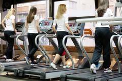 people running on machines, treadmill - stock photo