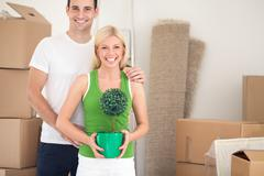 Stock Photo of smiling couple in new apartment