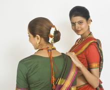 Two female folk dancers standing together in traditional Maharashtrian dress Stock Photos