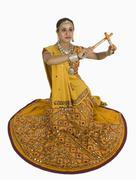 Woman performing dandiya - stock photo