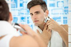 shaving by electric shaver - stock photo