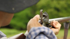 Pioneer man firing a musket in slow motion Stock Footage