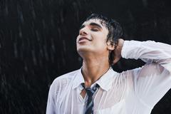 Stock Photo of Businessman enjoying in the rain