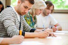 College student trying to copy test Stock Photos