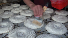 'Oiling' dough in Uzbek bakery, ready to bake fresh bread Stock Footage