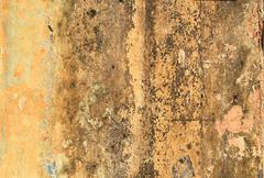 Dirty yellow concrete wall Stock Photos
