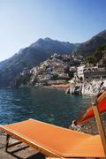 Stock Photo of Reclining chair at the waterfront, Amalfi, Province Of Salerno, Gulf Of Salerno,