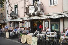 Tourists at a sidewalk cafe, Taormina, Province of Messina, Sicily, Italy Stock Photos