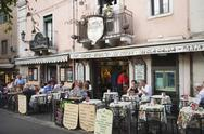 Stock Photo of Tourists at a sidewalk cafe, Taormina, Province of Messina, Sicily, Italy
