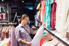 Woman in a clothing store Stock Photos
