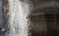 Low angle view of a fountain, St. Peters Square, Vatican City - stock photo