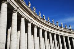 Low angle view of Berninis Column, St. Peters Square, Vatican City - stock photo