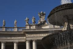 Low angle view of a fountain at St. Peters Square, Vatican City - stock photo