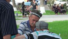 Bukhara, senior men playing game in the streets Stock Footage