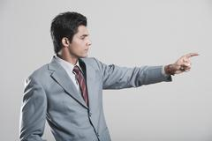 Businessman pointing away with finger Stock Photos