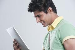 College student using a digital tablet - stock photo