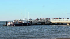 Ferry docking and boarding people, France Stock Footage