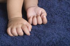 Close-up of baby hands - stock photo