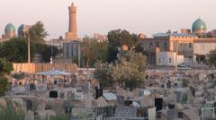 Graveyard, Bukhara skyline, mosque, Uzbekistan, Silk Road Stock Footage