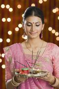 Woman holding a puja thali on Diwali - stock photo