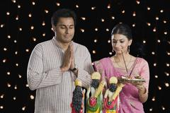 Couple praying on Diwali - stock photo