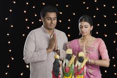 Couple praying on Diwali - stock photo