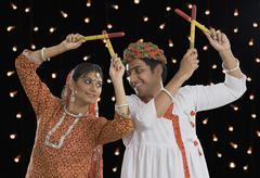 Couple performing Dandiya Raas at Navratri - stock photo