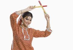 Woman performing Dandiya Raas at Navratri - stock photo