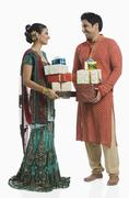 Couple holding gifts on Diwali - stock photo