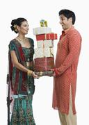 Stock Photo of Couple holding gifts on Diwali