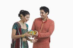Man giving gift to his wife on Diwali - stock photo