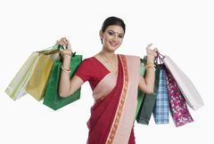 Stock Photo of Bengali woman carrying shopping bags