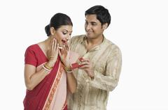 Bengali man giving gift to his wife - stock photo