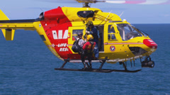 Westpac Lifesaver1 Rescue Helicopter searches coast line PT3 Stock Footage